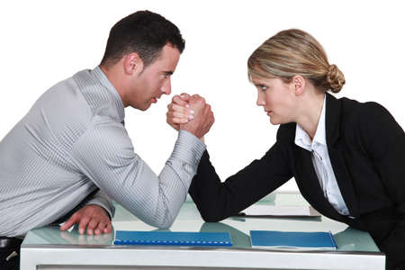 wrestling: arm wrestling between male and female colleagues