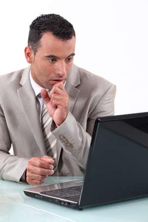 presentiment: A businessman holding his breath