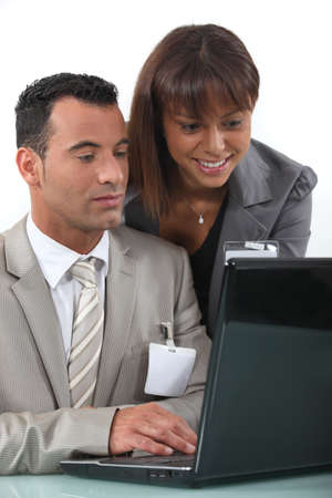 Two flirtatious businesspeople working together Stock Photo - 16166973