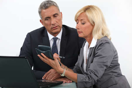 cost estimate: businessman and businesswoman calculating the budget Stock Photo