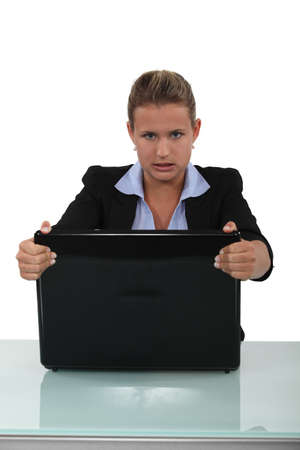 Woman frustrated with her briefcase photo