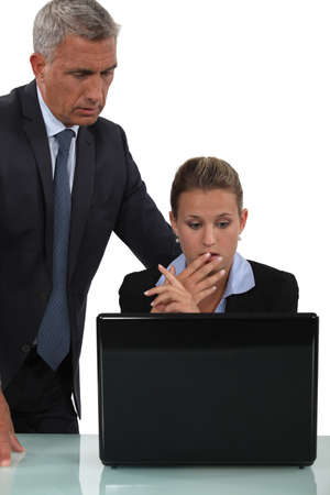 reprimanding: Boss reprimanding female employee