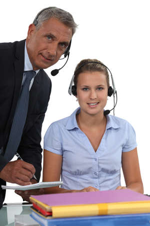 young female receptionist and mature male counterpart photo