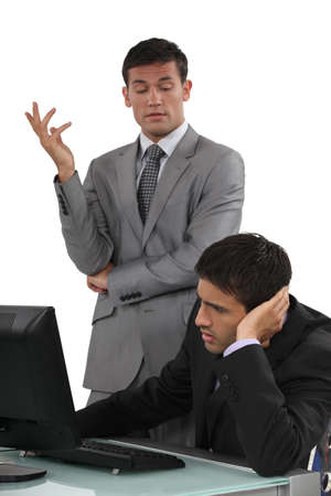 disapproval: Arrogant businessman talking to his colleague Stock Photo