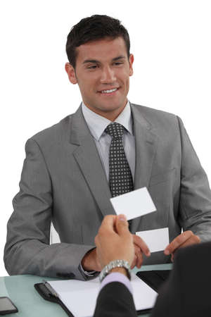 Two businessmen exchanging cards Stock Photo - 16166304