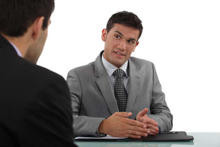 co workers: Man conducting interview