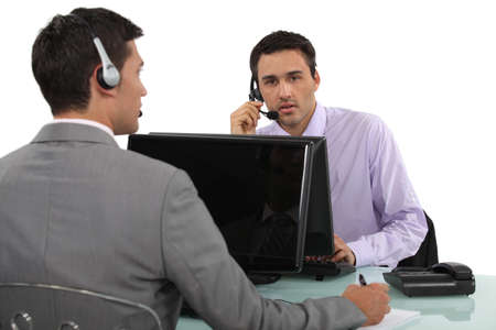 Businessmen with headsets and laptops Stock Photo - 16166887