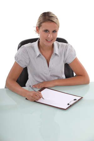 businesswoman working at her desk photo