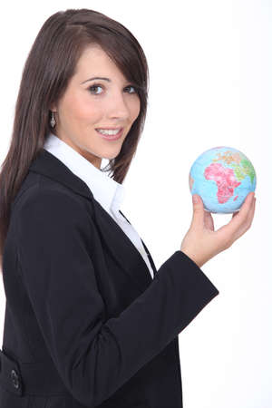 Young woman holding globe photo