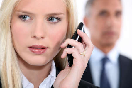 Woman listening to messages on her phone Stock Photo - 16166397