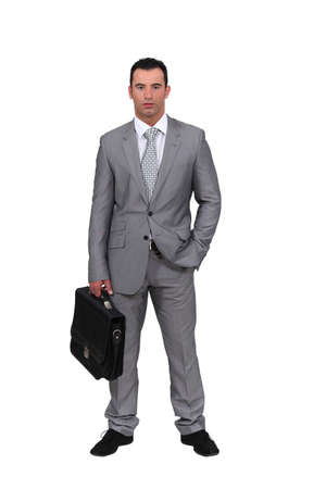 suit case: Man wearing an oversized suit Stock Photo