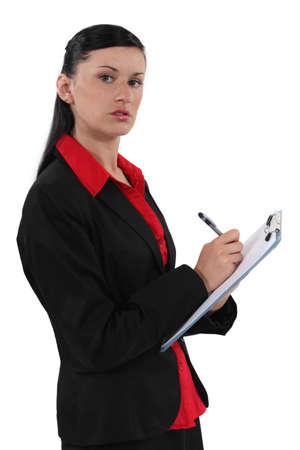 secretary writing on clipboard photo