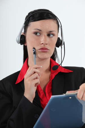 speculate: Call centre agent considering her options Stock Photo