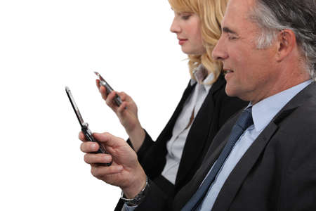 Business professionals sending text messages photo