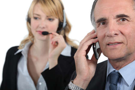 Boss and assistant making calls to customers Stock Photo - 16166420