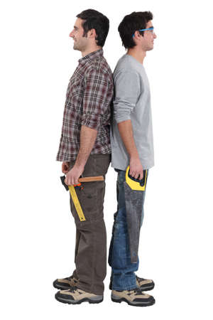 Two handymen stood back to back photo