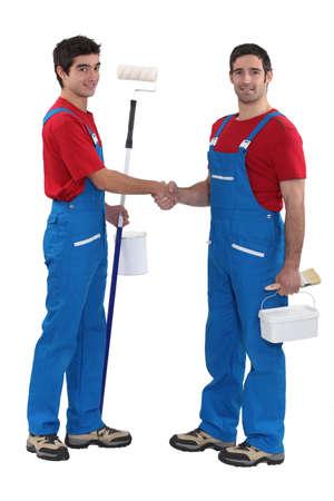 duo: duo of craftsmen shaking hands