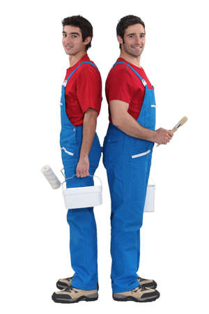 A team of painters standing back-to-back Stock Photo - 16166882