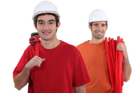 chums: Two plumbers Stock Photo