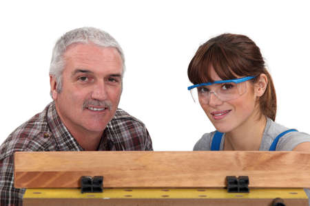 Carpenter working with his daughter photo