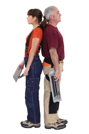 tradespeople: Tile fitters standing back to back