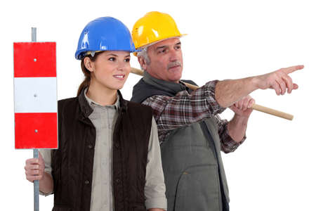 attention grabbing: Two workers Stock Photo