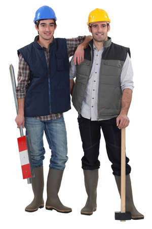 chums: Two manual worker friends stood together