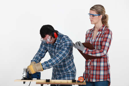 Woman supervising carpenter photo