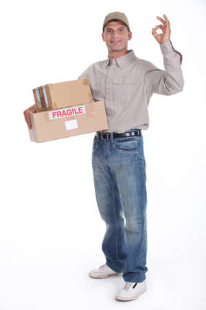 removal van: removal man holding boxes Stock Photo