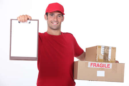 young man delivering parcels photo