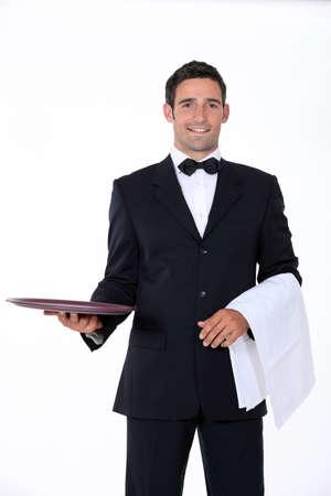 ottimo: cameriere ben vestito di fronte alla telecamera Archivio Fotografico