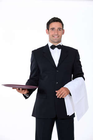 courtesy: well dressed waiter facing the camera Stock Photo