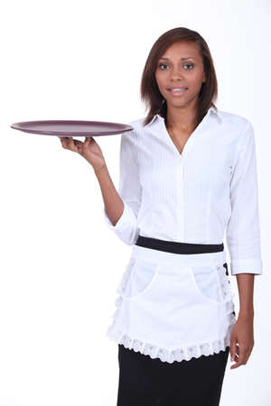 Waitress holding empty tray photo