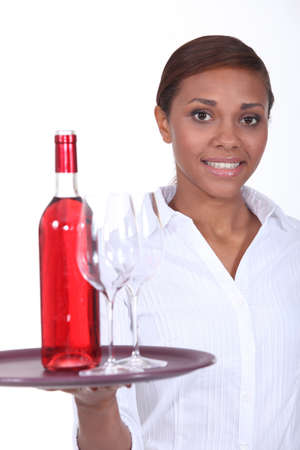 Waitress with a bottle of rose wine photo