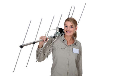 tv antenna: Woman carrying TV antenna