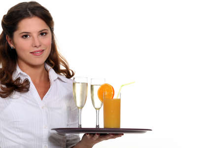 hospitality industry: Waitress carrying tray of drinks