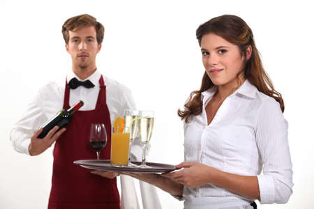 Wine waiter and waitress, studio shot photo