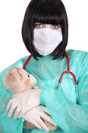 latex glove: Doctor hugging a teddy bear