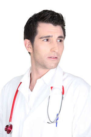 Isolated shot of a worried looking doctor photo