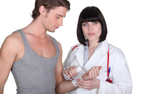 gauze: Doctor wrapping gauze around a patient