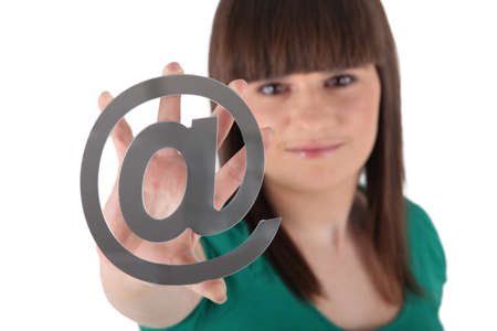 Teen showing at sign Stock Photo - 16166924
