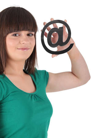 e mail: Girl holding an @ sign