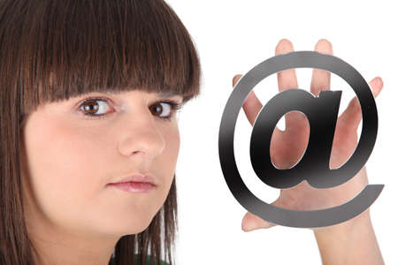 Teenage girl holding at symbol Stock Photo - 16166499