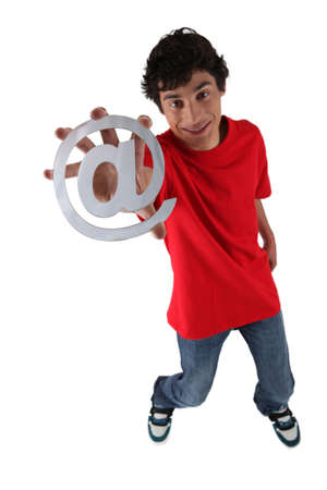 Teenage boy holding at symbol Stock Photo - 16154766