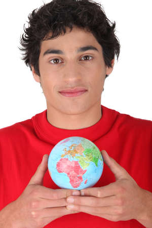 Man holding miniature globe photo