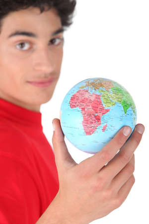 imply: Dark-haired boy with globe