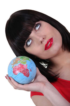 Smart woman with globe in hand photo