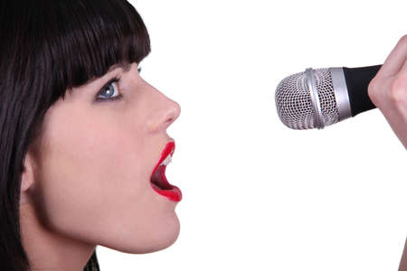 woman open mouth: Woman singing