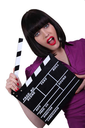 Funky woman with a clapper board photo