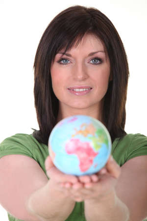 arm extended: Woman with globe Stock Photo